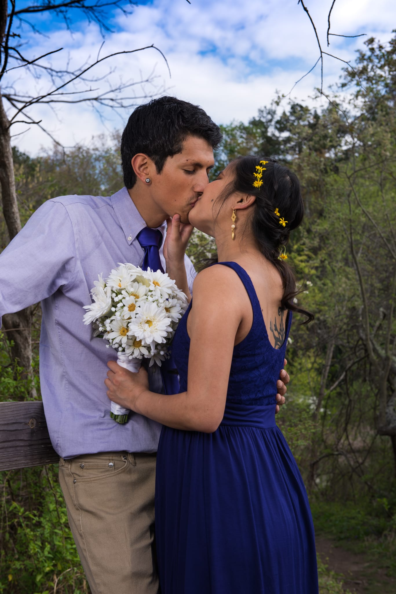 pretty couple elope kiss with bouquet